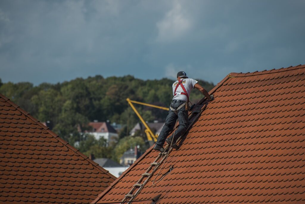 A person inspecting a roof.